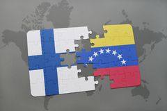 Puzzle with the national flag of finland and venezuela on a world map background. Stock Images