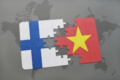 Puzzle with the national flag of finland and vietnam on a world map background. 3D illustration Royalty Free Stock Photo