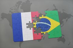 Puzzle with the national flag of france and brazil on a world map background. 3D illustration Stock Photography