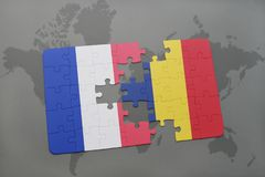 puzzle with the national flag of france and chad on a world map background. Stock Photo