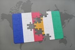 Puzzle with the national flag of france and cote divoire on a world map background. 3D illustration Royalty Free Stock Image