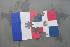 Puzzle with the national flag of france and dominican republic on a world map background. 3D illustration Royalty Free Stock Photography