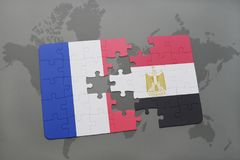 Puzzle with the national flag of france and egypt on a world map background. 3D illustration royalty free stock photography