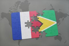 Puzzle with the national flag of france and guyana on a world map background. 3D illustration Royalty Free Stock Photography