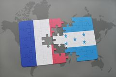 Puzzle with the national flag of france and honduras on a world map background. 3D illustration Royalty Free Stock Photos