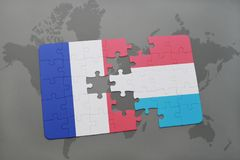 Puzzle with the national flag of france and luxembourg on a world map background. 3D illustration Stock Photos