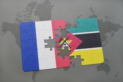 Puzzle with the national flag of france and mozambique on a world map background. 3D illustration Stock Photos