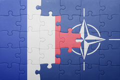 Puzzle with the national flag of france and nato. Concept Stock Images