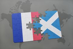 Puzzle with the national flag of france and scotland on a world map background. 3D illustration Royalty Free Stock Images