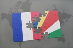 Puzzle with the national flag of france and seychelles on a world map background. 3D illustration Stock Photo