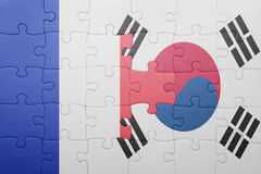 Puzzle with the national flag of france and south korea. Concept stock image