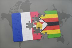 Puzzle with the national flag of france and zimbabwe on a world map background. 3D illustration Stock Photo