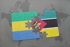 Puzzle with the national flag of gabon and mozambique on a world map Royalty Free Stock Images