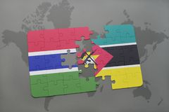 Puzzle with the national flag of gambia and mozambique on a world map. Background. 3D illustration Royalty Free Stock Photography
