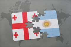 puzzle with the national flag of georgia and argentina on a world map Stock Photo