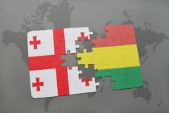 puzzle with the national flag of georgia and bolivia on a world map Stock Image
