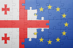 Puzzle with the national flag of georgia and european union. Concept Stock Images