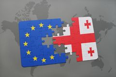 Puzzle with the national flag of georgia and european union on a world map. Background Stock Photos