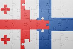 Puzzle with the national flag of georgia and finland Royalty Free Stock Image