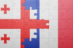 Puzzle with the national flag of georgia and france. Concept Royalty Free Stock Photos