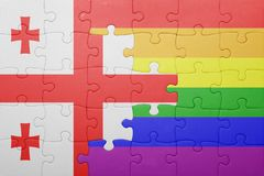Puzzle with the national flag of georgia and gay flag. Concept Stock Image