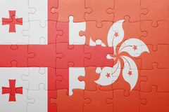 Puzzle with the national flag of georgia and hong kong Royalty Free Stock Image
