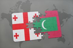 Puzzle with the national flag of georgia and maldives on a world map Royalty Free Stock Photography