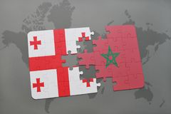 Puzzle with the national flag of georgia and morocco on a world map. Background. 3D illustration stock photography