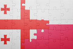 Puzzle with the national flag of georgia and poland. Concept Stock Photography
