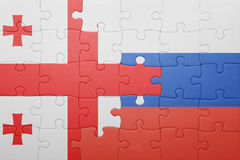 Puzzle with the national flag of georgia and russia Stock Photo