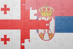 Puzzle with the national flag of georgia and serbia . concept. Puzzle with national flag of georgia and serbia . concept Stock Image