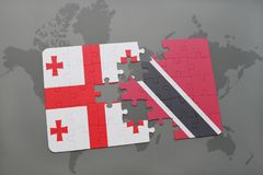 puzzle with the national flag of georgia and trinidad and tobago on a world map Stock Photo