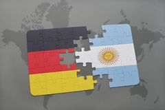Puzzle with the national flag of germany and argentina on a world map background. 3D illustration royalty free stock photo