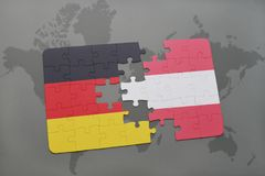 Puzzle with the national flag of germany and austria on a world map background. 3D illustration Royalty Free Stock Images