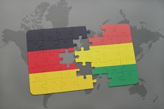 Puzzle with the national flag of germany and bolivia on a world map background. 3D illustration royalty free stock images