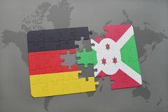 Puzzle with the national flag of germany and burundi on a world map background. 3D illustration stock photography