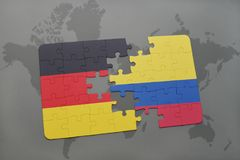 Puzzle with the national flag of germany and colombia on a world map background. 3D illustration stock photo