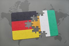 Puzzle with the national flag of germany and cote divoire on a world map background. 3D illustration Royalty Free Stock Photo
