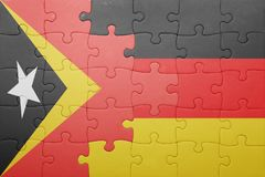 Puzzle with the national flag of germany and east timor Stock Photography