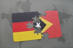 puzzle with the national flag of germany and east timor on a world map background. Royalty Free Stock Photo