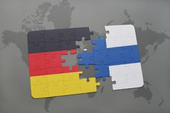 Puzzle with the national flag of germany and finland on a world map background. Stock Photo