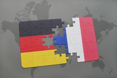 Puzzle with the national flag of germany and france on a world map background. 3D illustration Stock Photo