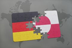 Puzzle with the national flag of germany and greenland on a world map background. 3D illustration royalty free stock photography