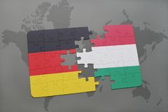 Puzzle with the national flag of germany and hungary on a world map background. 3D illustration Royalty Free Stock Photo
