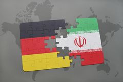 Puzzle with the national flag of germany and iran on a world map background. 3D illustration royalty free stock photos
