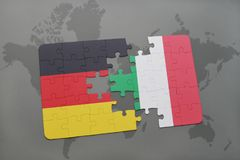 Puzzle with the national flag of germany and italy on a world map background. 3D illustration Royalty Free Stock Photo