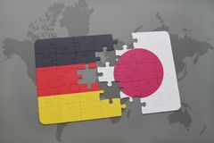 Puzzle with the national flag of germany and japan on a world map background. 3D illustration royalty free stock images