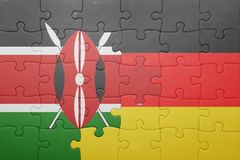 Puzzle with the national flag of germany and kenya. Concept stock photos
