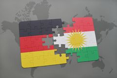 Puzzle with the national flag of germany and kurdistan on a world map background. 3D illustration stock photos