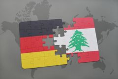 Puzzle with the national flag of germany and lebanon on a world map background. 3D illustration royalty free stock photo